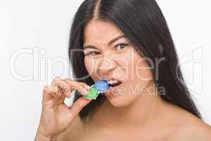 Woman with container for contact lenses