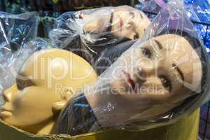 Mannequin Shop Dummy Heads in Plastic Bags