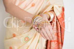 Woman in Indian sari dress wearing bangles