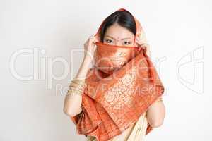Secrecy young girl in Indian sari dress