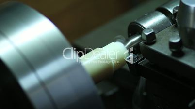 Close up turning lathe in action