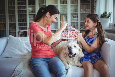 Happy mother checking the surprise gift given by daughter