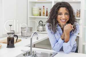 Young Woman Perfect Teeth and Smile in Kitchen
