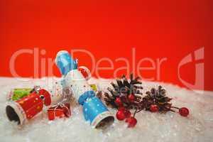 Christmas crackers and christmas decoration on snow