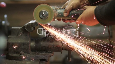 Worker cutting metal workpiece with circular saw