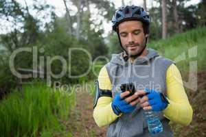 Mountain biker using mobile phone