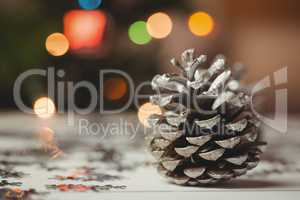 Close-up of pine cone on wooden table