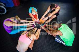 High angle view of friends stretching in gym