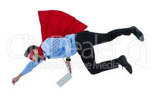 Businessman pretending to be a super hero holding laptop