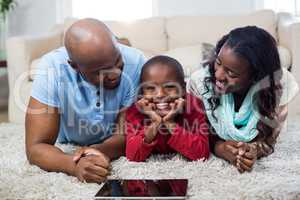 Family with digital tablet