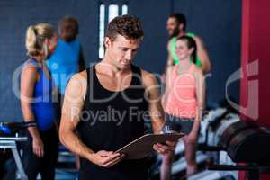 Gym trainer with clipboard