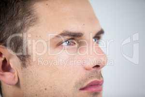 Close-up of man wearing contact lens