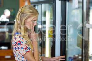 Woman looking at refrigerator