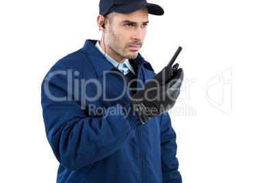 Security officer talking on walkie-talkie