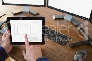 Security officer using digital tablet at desk