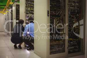 Technicians analyzing server