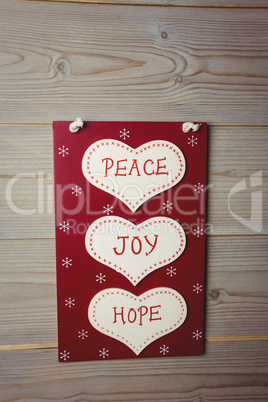 Christmas label with massages of peace, joy and hope
