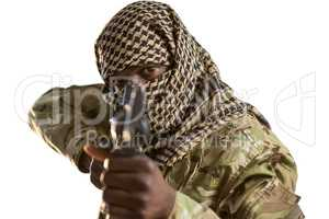Portrait of soldier aiming with a rifle