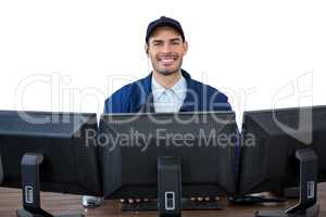 Portrait of happy security officer using computer