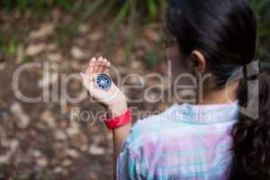 Female hiker looking at compass