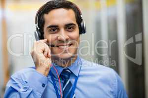 Portrait of technician talking on head phones
