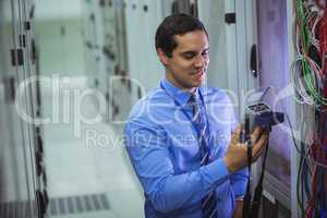 Technician using digital cable analyzer