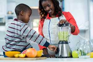 Woman and son using mixer