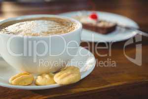 Cappuccino with cookies on plate