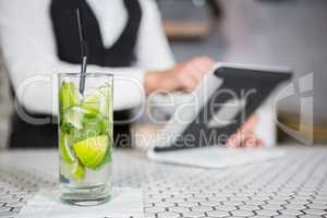 Glass of mojito on a bar counter
