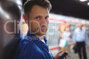 Portrait of handsome man listening song on mobile phone