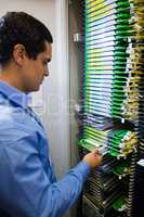 Technician checking routers