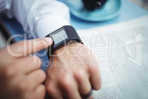 Man adjusting time on smartwatch