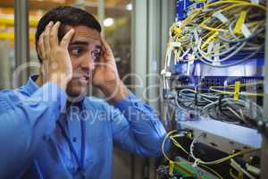 Technician getting stressed over server maintenance