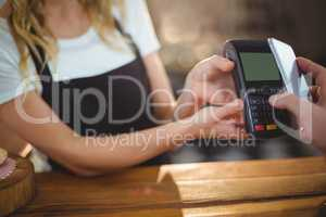 Customer paying bill through smartphone using NFC technology