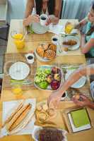 Overhead view of family sitting at breakfast table