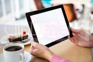 Woman holding a digital tablet in the coffee shop
