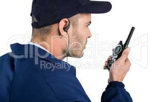 Close-up of security officer talking on walkie-talkie