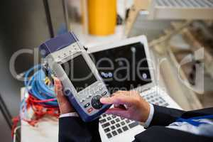 Technician using digital cable analyzer