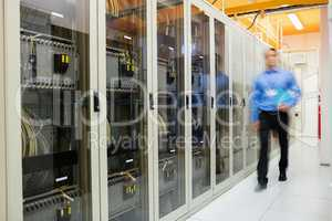 Technician walking in server room