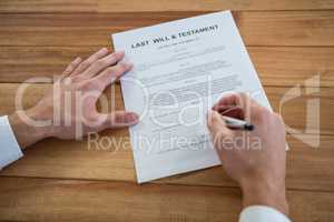 Businessman filling last will and testament form