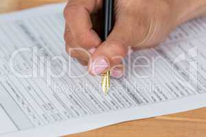 Businesswoman filling insurance contract form