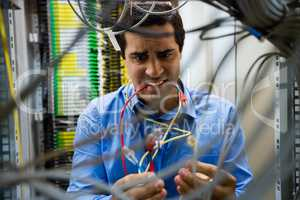 Technician fixing cable