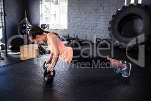 Sporty female athlete doing push-ups