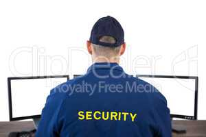 Rear view of security officer using computer