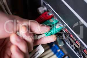 Technician plugging ethernet in a rack mounted server