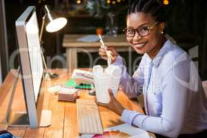 Businesswoman noodles box at her desk