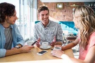 Friends talking in the coffee shop