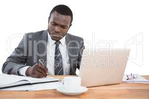 Concentrated businessman working at office desk