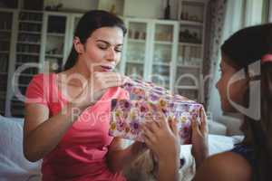 Mother looking at the surprise gift given by her daughter