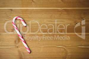 Candy cane on wooden table